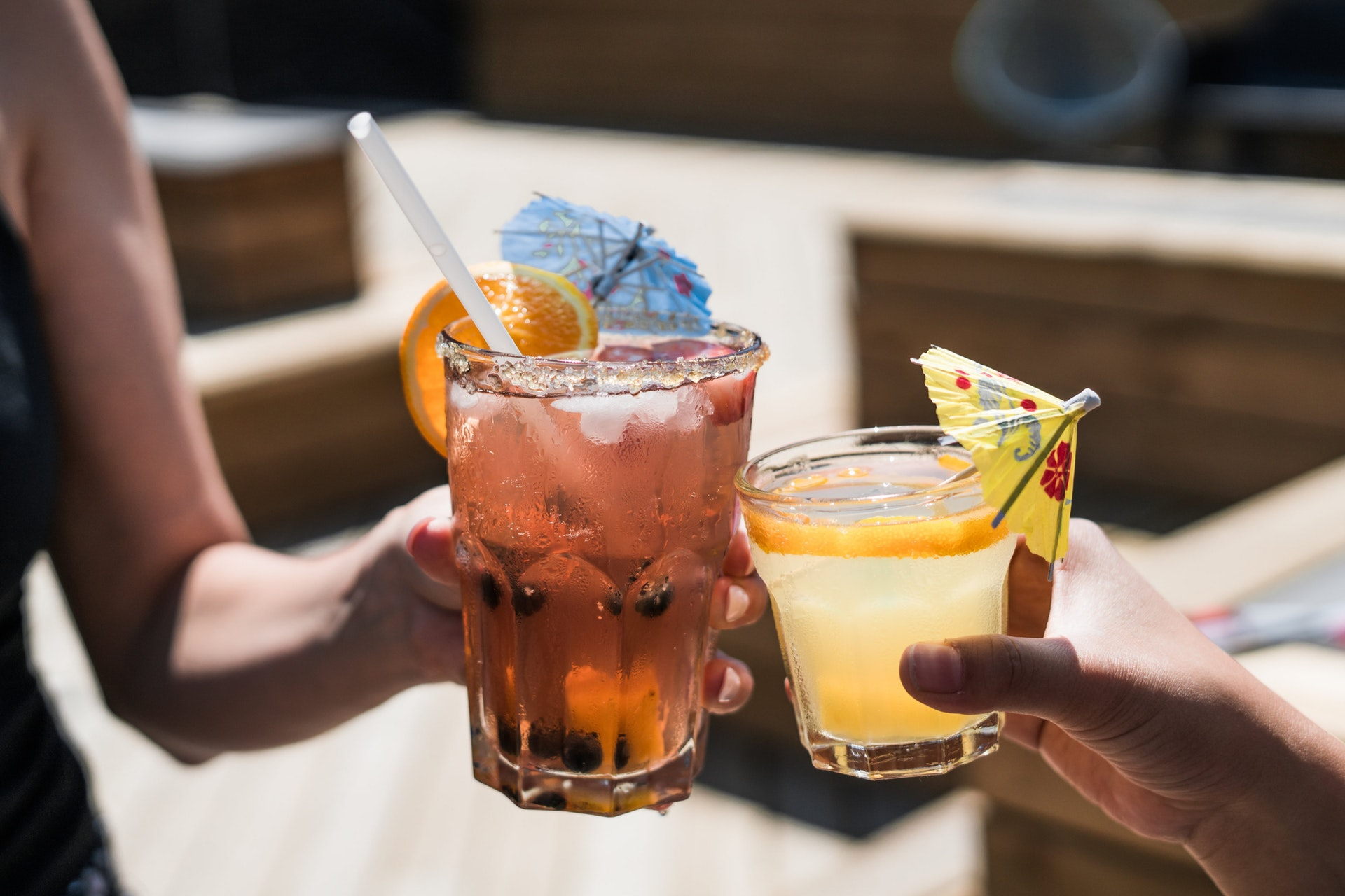 Alcoholic cocktai s served in backyard of open house