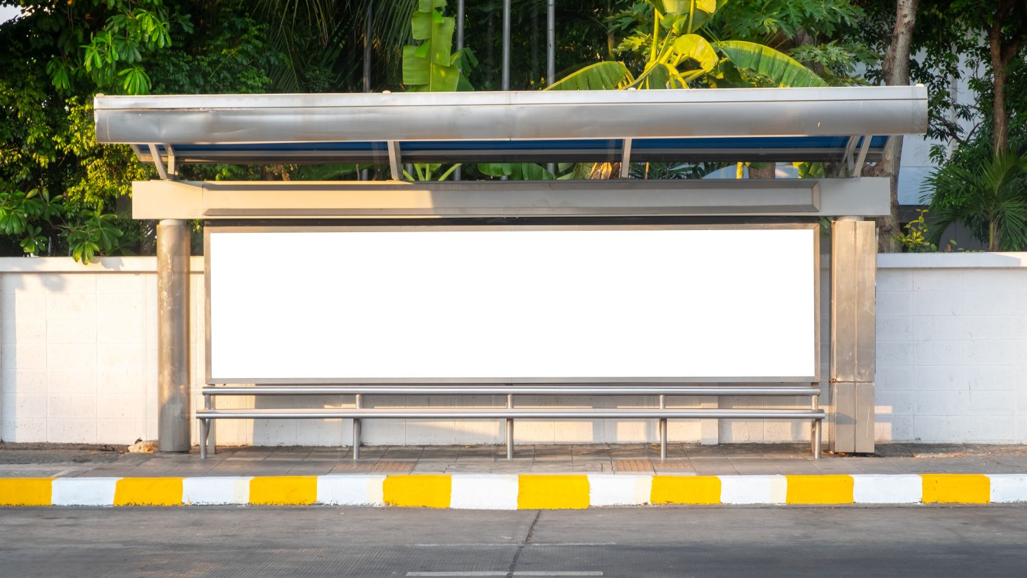 Bus stop bench with blank advertising space