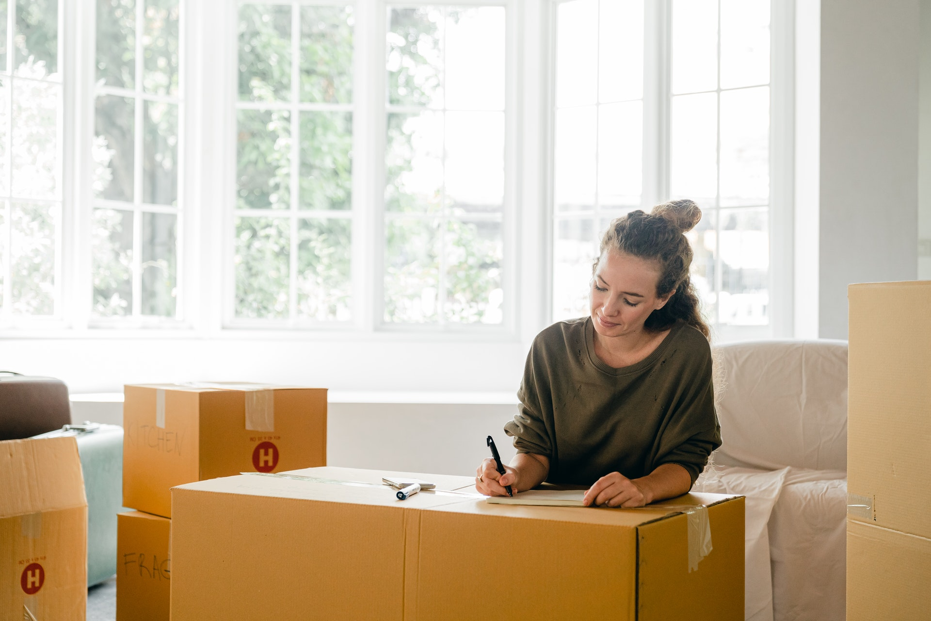 California resident packing boxes and moving to texas