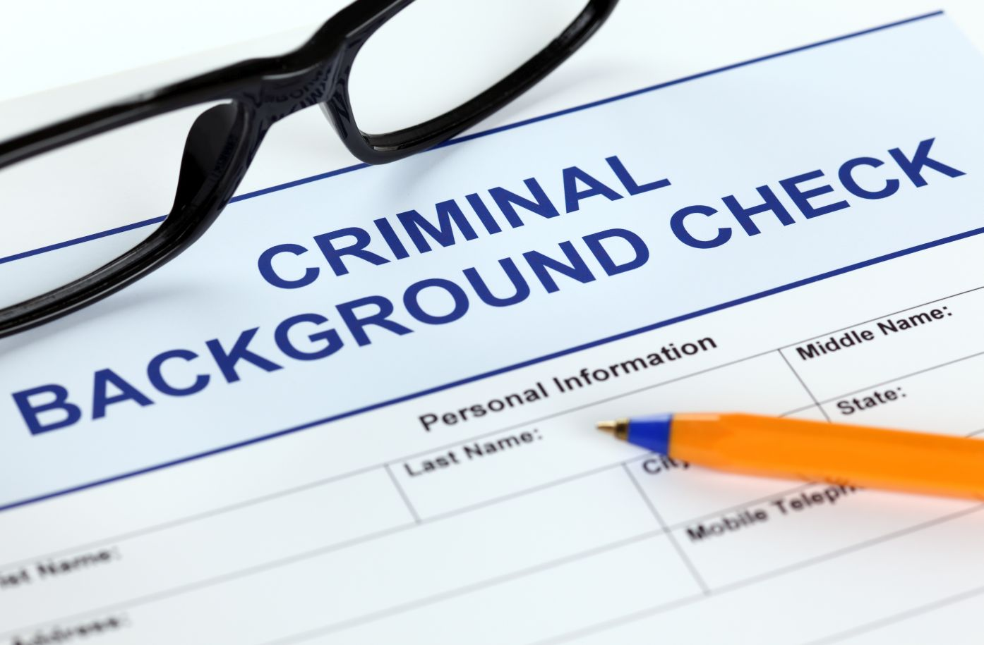 Criminal background check paperwork being filled out