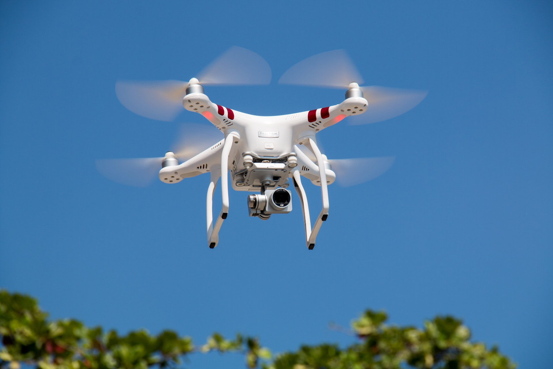 Drone flying taking pictures and video recording real estate property