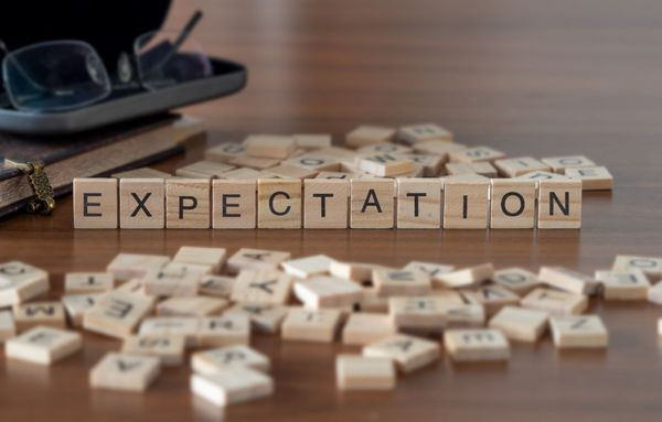 Expectation spelled out using scrabble pieces