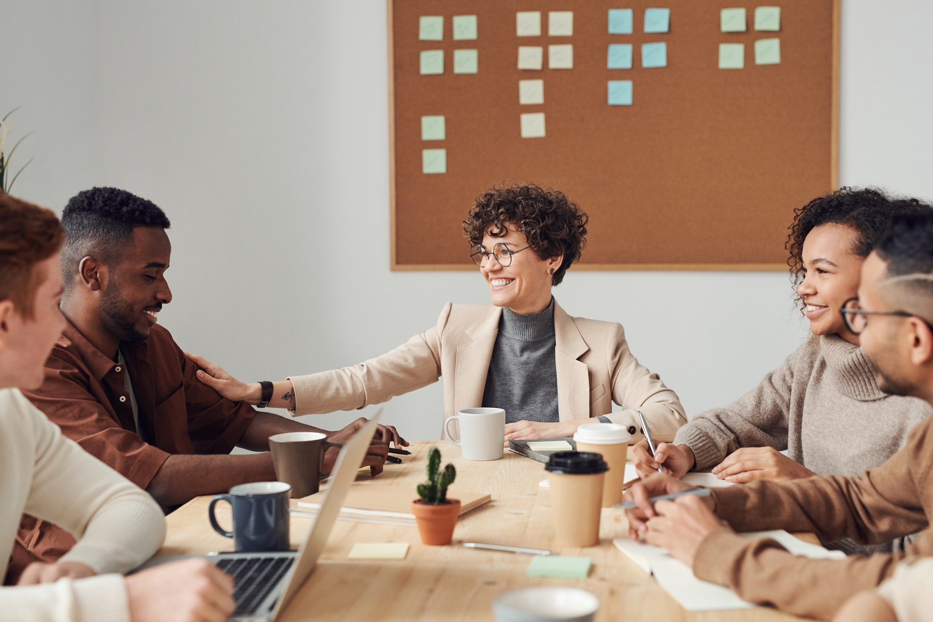 Female real estate agent smiling while conducting meeting