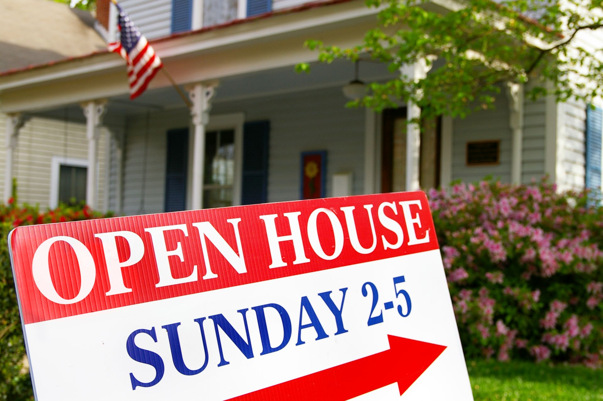 Open house sign in front of a home for sale