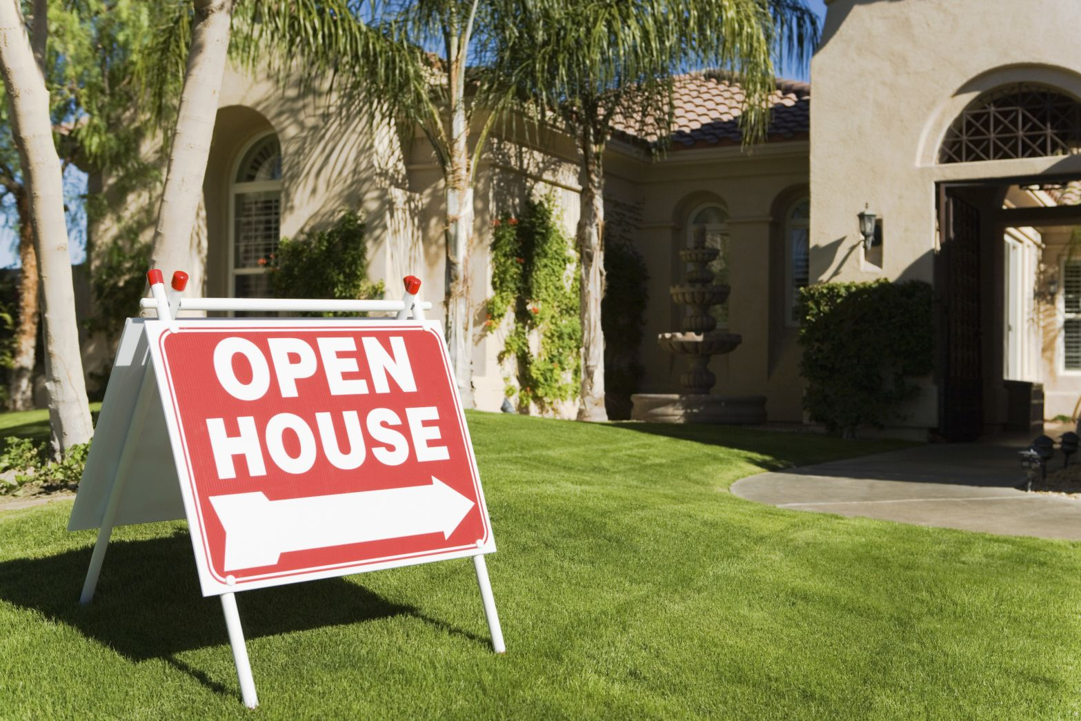Open house sign on front lawn outside of house