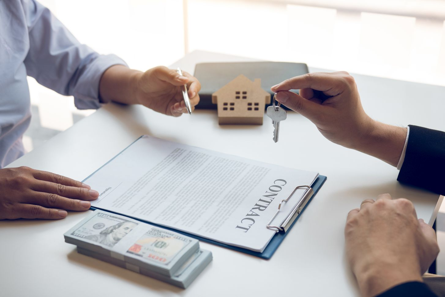 Purchase contract in front of realtor and prospective home buyers