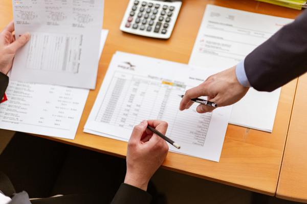 Real estate agent calculating closing costs with client