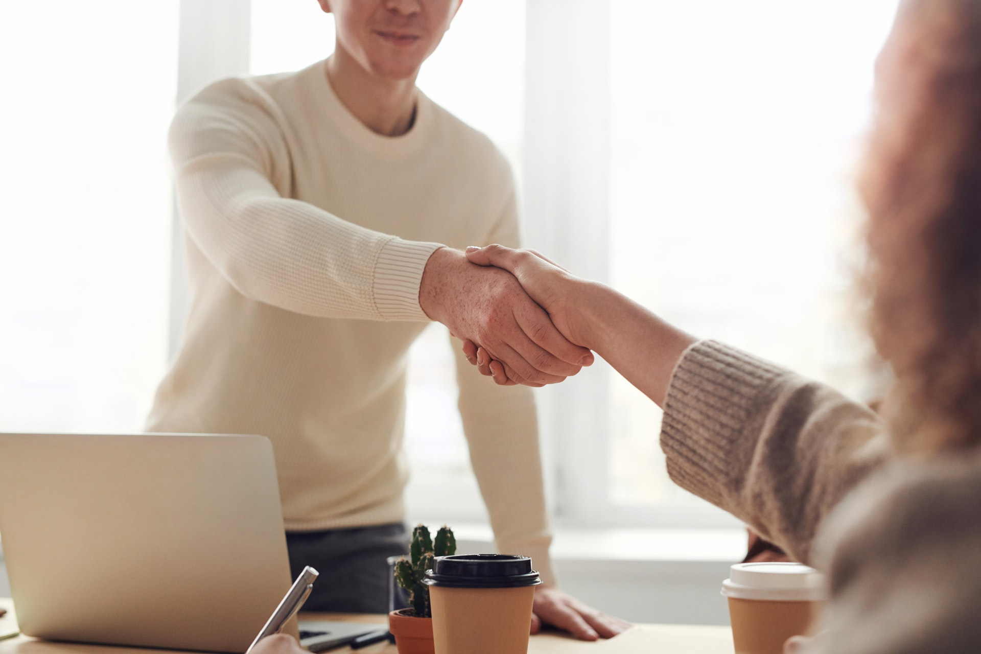 Real estate agent shaking clients hand