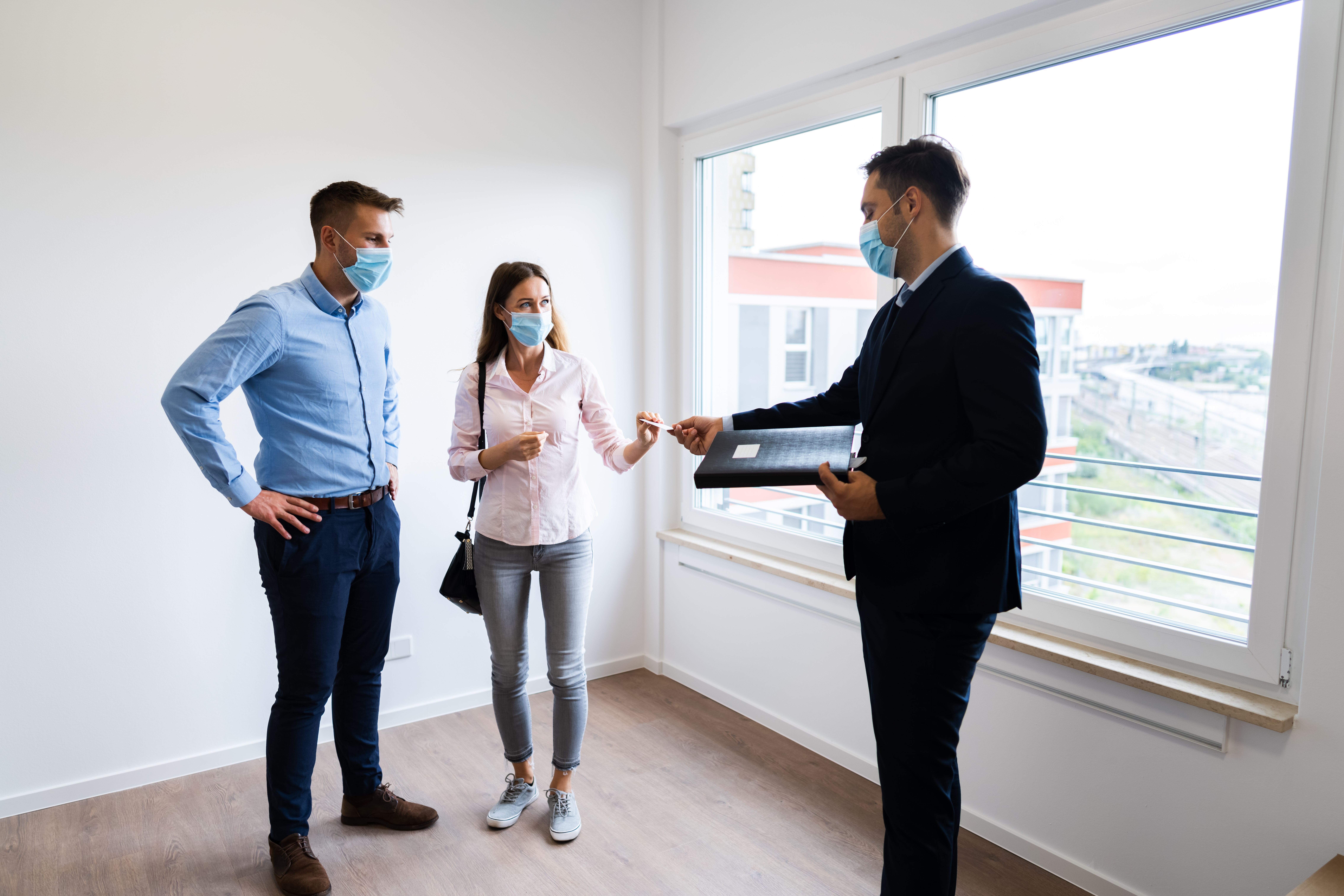 Real estate agent showing a home for sale during covid 19
