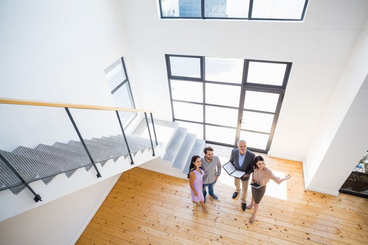 Real estate agents showing house to first time home buyers