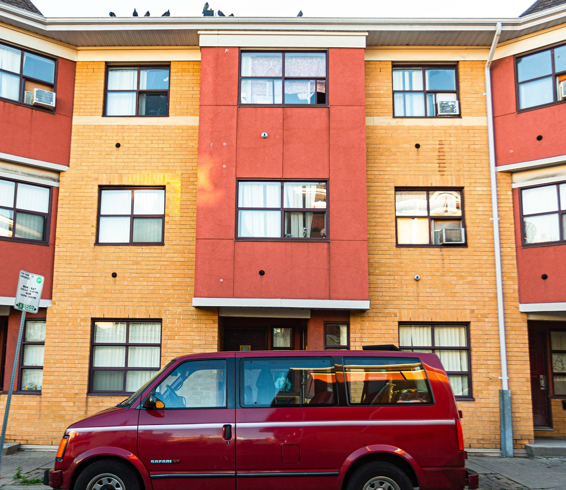 Red van parked outside of section 8 housing